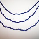 Electric Blue Triple strand necklace with earrings.