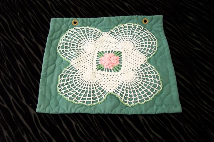 Large Doily with Pink Motif on Green Pillow Form *