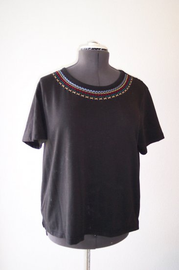 Black knit top with embroidered scoop neckline *