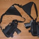 Shoulder holster with two holsters