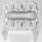 Ninety-Four points of ice Dracula style rhodium playa grillz top and bottom combo