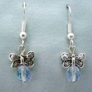Silvertone butterfly and blue crystal bead earrings