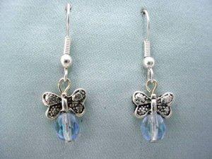 Silvertone butterfly and blue crystal bead earrings