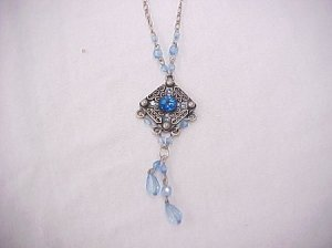 Diamond shaped pendant with blue beaded dangle necklace