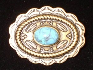 Vintagey  Brooch-Goldrtone  or silvertone concho with paua shell