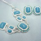 Turquoise color lucite and rhinestone necklace & earring set