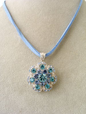 Silver, clear and blue crystal pendant;blue suede necklace