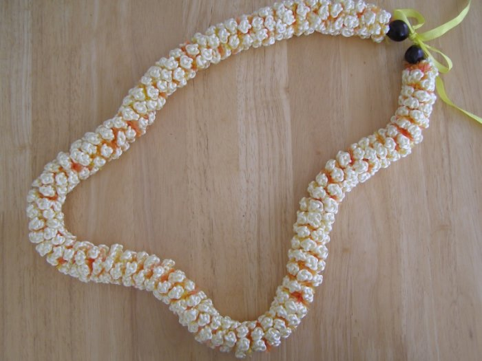 Hawaiian crochet lei rosette w/ ivory satin rattail cord orange eyelash yarn