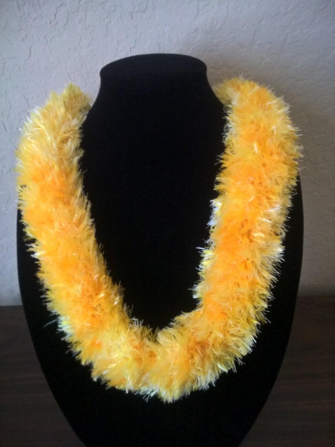 Hawaiian lei hat band knit w/ yellow multi-color eyelash yarn