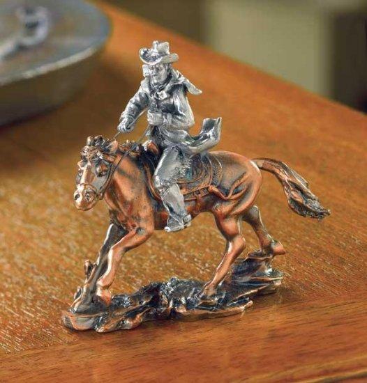COWBOY ON HORSE FIGURINE