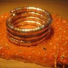 Tri-color (gold/silver/copper) spiral coil bangle