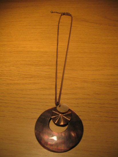 Brown shell medallion on brown chain