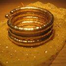 Gold spiral coil metal bangle