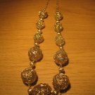 Gold tone wire 11 ball necklace