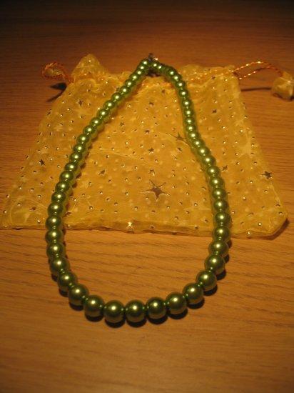 String of dark green faux pearls