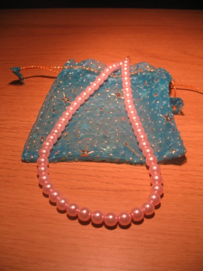 String of light pink faux pearls