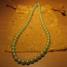 String of light green faux pearls