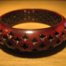Brown resin bangle with 4-pointed star perforations
