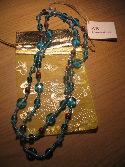 Turquoise glass and brown wood bead long necklace