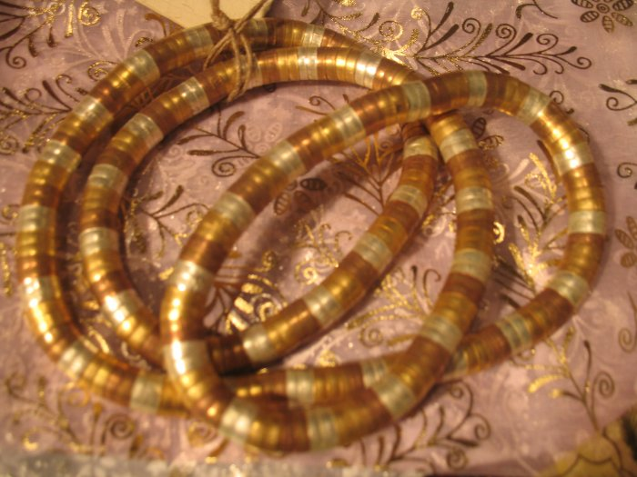 Twist metal necklace in gold, silver and copper