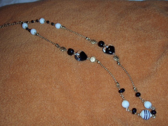 Black, white and gold glass, ceramic and metal bead necklace