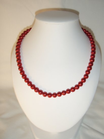 String of red faux pearls