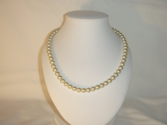 String of white faux pearls