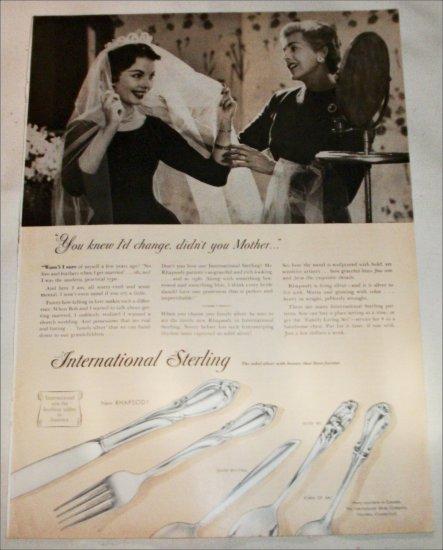1957 International Sterling Silverware Change ad