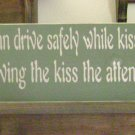 Primitive Sign, Any man who can drive safely while kissing a pretty lady simply is not giving