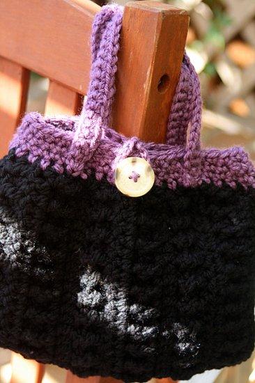 Black and lavender handbag