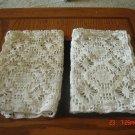 A pair of crochet place mat