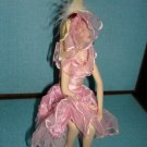 "Beautiful porcelin doll with pink dress and veil in sitting position 7""x5""X4"""