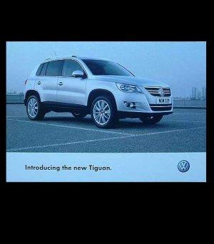 VW VOLKSWAGEN TIGUAN ADVERTISING POSTCARD FROM THE UK