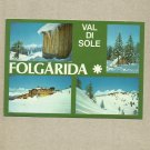 FOLGARIDA VAL DI SOLE ITALY MULTIVIEW POSTCARD ITALIAN STAMP AND CANCELLATION 1985