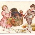 1912 Embossed Vintage Thanksgiving Postcard Boy Girl Turkey in Basket