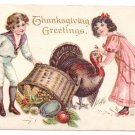 1912 Embossed Vintage Thanksgiving Postcard Boy Girl Turkey Spilled Basket