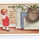 Christmas Boy Hangs Basket on Fireplace Vintage Postcard