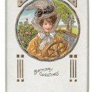 Embossed Birthday Greetings Woman Fancy Hat Behind Wheel of Car Gilded Postcard
