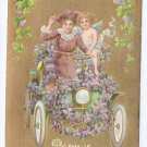 Vintage Valentine Postcard Cupid Cherub Car Lady Gold Moire Background Shamrocks Automobile