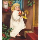 Christmas Santa Claus Girl with Candle and Doll Embossed Artist Signed Clapsaddle Postcard