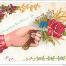 Greetings from Des Moines IA Hand w Silk Rose Bud Vintage Postcard