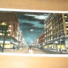 Vintage Central Avenue At Night Looking East Fort Dodge Iowa Postcard