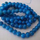 "Blue and Black 8mm Glass Beads - 1 30"" strand"