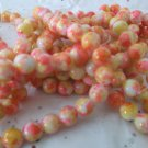 "Yellow and Orange Mottled Beads - 16"" strand"