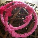 6 1/2in. Pink & wire round bracelets.
