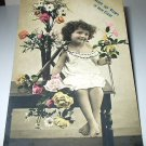 All Smiles with Little Girl Surrounded by Flowers-Used Antique 1907 Postcard