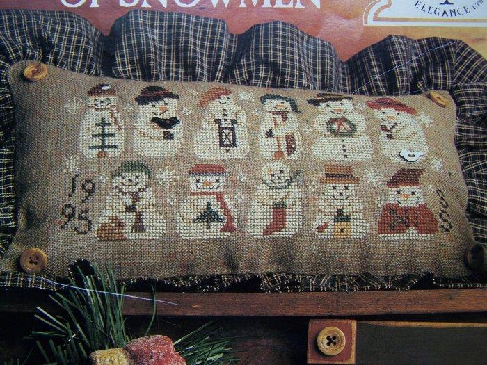 Homespun Elegance A Gathering of Snowmen Cross Stitch Pattern 146