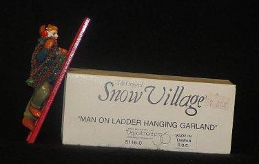 MAN ON LADDER HANGING GARLAND