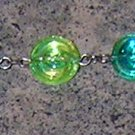 A7-Green Swirl Glass Beaded Iridescent Bracelet