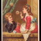 Victorian Trade Card - Arbuckle Brothers Coffee Company - Boy with Girl Blowing Bubbles (#97)